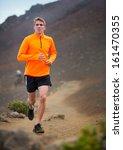 athletic man jogging outside ... | Shutterstock . vector #161470355