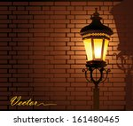 Glowing Street Lamp Against A...