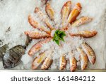 Fresh fishes seafood background on ice decorated with paprika pepper, Azores, Portugal - stock photo