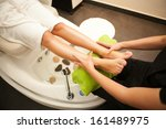 therapist hands giving a legs... | Shutterstock . vector #161489975