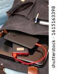 smartphone charging of a power... | Shutterstock . vector #1615163398
