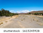 Dry River Bed In A Valley With...