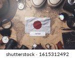 japan flag between traveler's... | Shutterstock . vector #1615312492
