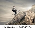 young businessman pedaling a... | Shutterstock . vector #161543966