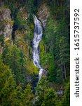 Waterfall Flows Down A Cliff...