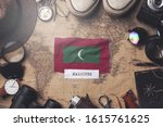 maldives flag between traveler... | Shutterstock . vector #1615761625