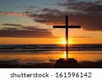 Dark Cross At Beach As The Sun...