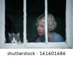 Woman And Cat Looking At The...