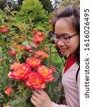 Beautiful Girl In Rose Garden...