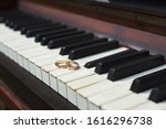 Wedding Rings Lie On The Keys...
