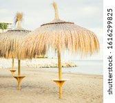 Small photo of Several straw sunshade on beach