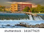 driftwood log on top of dam on... | Shutterstock . vector #161677625