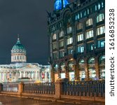 Small photo of Griboedov Canal Embankment; Zinger House and Kazan Cathedral against the background of the night sky. Russia