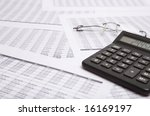 good black cacalculate, on the financial sheet - stock photo