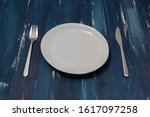 white round plate with utensils ... | Shutterstock . vector #1617097258