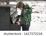 Boy Playing Piano Outdoors. Bo...