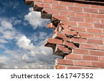 Broken Brick Wall And Blue Sky...
