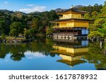 The Golden pavillion at Kinkaku-ji temple - The world heritage site with reflections in the water. Autumn season in Kyoto, Japan.