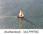 Sailboat Sailing On Peaceful...