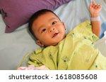 southeast asian boy  6 months... | Shutterstock . vector #1618085608