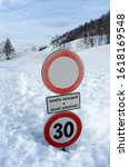 Small photo of road sign buried by snow, with written in Italian: except velocipedes and authorized vehicles