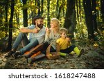 Cheerful Family Sitting On The...