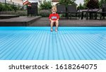 Small photo of Automatic swimming pool covering system, safely protect children and pets from accidental contact with water, home and cottage equipment, copyspace, place for text, outdoor exterior, soft focus