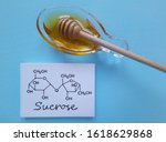 Small photo of Structural chemical formula of sucrose molecule with a bowl of honey. It is a disaccharide molecule composed of glucose and fructose. Honey gets its sweetness from fructose, glucose, and sucrose.