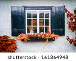 Front Of English House In Autumn
