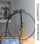 Small photo of Nelson, New Zealand - 22 December 2019: The PENNY FARTHING with 1,5m diameter front wheel and direct drive, built in 1870, was the first machine to be called a bicycle. Exhibited in the Founders Park