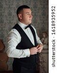 stylish groom portrait getting... | Shutterstock . vector #1618935952
