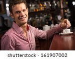 man with a cup of coffee at the ... | Shutterstock . vector #161907002