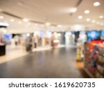 Blurred image of duty free Shop at the airport, people buy goods at the duty free shop at the airport. Out of focus photo airport