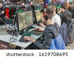 Small photo of KYIV, UKRAINE - APRIL 06, 2019: People playing computer games at Republic of Gamers booth, a brand used by Asus since 2006, encompassing a range of PC gaming. CEE 2019, electronics trade show.