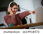 Young Woman In Office With...