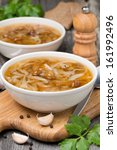 Small photo of traditional Russian cabbage soup (shchi) with wild mushrooms and garlic, vertical