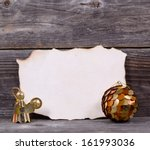 Christmas background with blank vintage paper and golden ornaments - stock photo