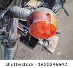 Small photo of motorcycle blinker light, Orange Blinker, Automotive part, motorcycle turn signals, Indicator Light for bike close up