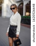 Young Stylish Woman Walking On...