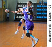 Small photo of GALATI, ROUMANIA - MAY 18: Unidentified players in action at Roumanian Handball National Championship . match (HC Danubius Galati vs.HC Roman) May 18, 2013 in Galati, Roumania.