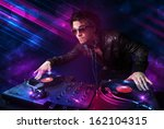 attractive young dj playing on... | Shutterstock . vector #162104315
