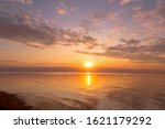 Calm Sea With Sunset Sky And...