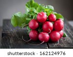 Fresh Radishes On Old Wooden...