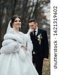 bride and groom posing. the... | Shutterstock . vector #1621319602