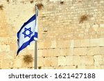 Small photo of Israel National Flag against the Kotel Wailing Western Wall the remnant of the Jewish Temple's, the most sacred site recognized by the Jewish faith outside of the Temple Mount itself.