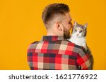 Man With Cute Cat On Color...