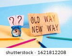 Conceptual hand writing showing Old Way New Way. Business photo showcasing The different way to fulfill the desired purposes Mini size alarm clock beside stationary on pastel backdrop.