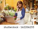 smiling mature woman florist... | Shutterstock . vector #162206255