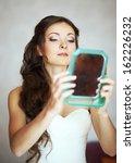 bride enjoying herself looking... | Shutterstock . vector #162226232