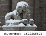 Snow Covered Stone Lion...
